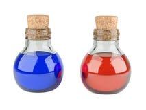 Μικρά μπουκάλια με έναν φελλό που γεμίζουν με το κόκκινο και blueliquid ΙΑΤΡΙΚΗ έννοια στοκ φωτογραφία με δικαίωμα ελεύθερης χρήσης