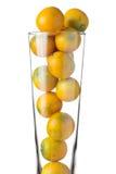Μικρά πορτοκάλια στο γυαλί   άσπρο υπόβαθρο Στοκ Εικόνα