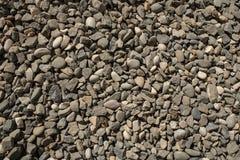 Μικρά χαλίκια σύστασης χαλικιών αμμοχάλικο, οικοδομικό υλικό ή απορρίμματα στοκ εικόνα με δικαίωμα ελεύθερης χρήσης