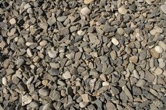 Μικρά χαλίκια σύστασης χαλικιών αμμοχάλικο, οικοδομικό υλικό ή απορρίμματα στοκ εικόνες