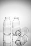 Μικρή έκδοση 2 μπουκαλιών γυαλιού τρία Στοκ Εικόνες