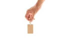 μικρή καφετιά ετικέττα εκμετάλλευσης χεριών αρσενική, τιμή, ετικέττα δώρων, ετικέττα πώλησης Στοκ Εικόνα