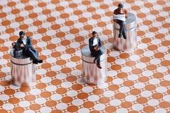 Μικροσκοπικό κάθισμα ανθρώπων Στοκ Εικόνες