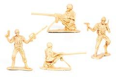 Μικροσκοπικό παιχνίδι στρατιωτών στο λευκό Στοκ Εικόνα