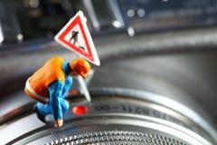 Μικροσκοπικό πρότυπο αριθμού συντήρησης που τίθεται στο μέρος φακών της ψηφιακής κάμερα Στοκ Εικόνες