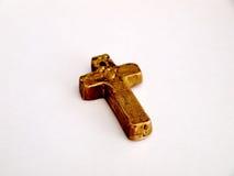 Μικρός παλαιός παχύς σταυρός ορείχαλκου Στοκ εικόνες με δικαίωμα ελεύθερης χρήσης
