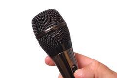 Μικρόφωνο στο ανθρώπινο χέρι Στοκ Φωτογραφίες