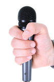 μικρόφωνο s ατόμων χεριών Στοκ εικόνες με δικαίωμα ελεύθερης χρήσης