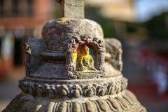 Μικρό άγαλμα του Βούδα που χαράζεται στην πέτρα στοκ εικόνα με δικαίωμα ελεύθερης χρήσης