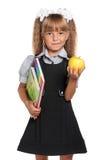 Μικρό κορίτσι με τα βιβλία άσκησης Στοκ Εικόνες