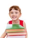 Μικρό κορίτσι με τα βιβλία Στοκ εικόνες με δικαίωμα ελεύθερης χρήσης