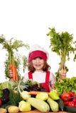Μικρό κορίτσι με τα καρότα και τα λαχανικά Στοκ Φωτογραφίες