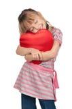 Μικρό κορίτσι με την κόκκινη καρδιά Στοκ εικόνα με δικαίωμα ελεύθερης χρήσης