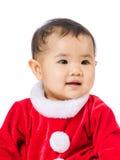 Μικρό κορίτσι με τη σάλτσα Χριστουγέννων στοκ εικόνες