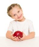 Μικρό κορίτσι με το μήλο Στοκ Φωτογραφία