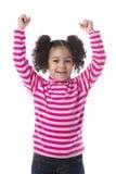 Μικρό κορίτσι που αυξάνει τα όπλα της Στοκ Εικόνες