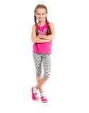 Μικρό κορίτσι που στέκεται με τα χέρια στις πλευρές στοκ εικόνες
