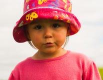 Μικρό κορίτσι σε ένα καπέλο Στοκ Φωτογραφίες