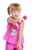 Μικρό κορίτσι σε ένα ρόδινο κοστούμι Στοκ φωτογραφία με δικαίωμα ελεύθερης χρήσης