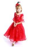 Μικρό κορίτσι σε μια κόκκινη εσθήτα σφαιρών Στοκ εικόνα με δικαίωμα ελεύθερης χρήσης