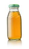 Μικρό μπουκάλι χυμού μήλων Στοκ Εικόνες