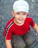 Μικρό παιδί που έχει τη διασκέδαση στοκ εικόνα με δικαίωμα ελεύθερης χρήσης