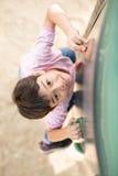 Μικρό παιδί που επάνω η γενναία παιδική χαρά Στοκ φωτογραφίες με δικαίωμα ελεύθερης χρήσης