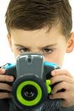 Μικρό παιδί που επικεντρώνεται στη κάμερα του Στοκ εικόνες με δικαίωμα ελεύθερης χρήσης
