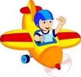 Μικρό παιδί σε ένα αεροπλάνο Στοκ εικόνες με δικαίωμα ελεύθερης χρήσης