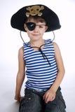 Μικρό παιδί στο κοστούμι πειρατών στο λευκό Στοκ εικόνες με δικαίωμα ελεύθερης χρήσης