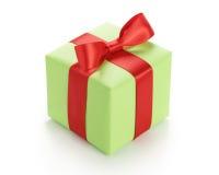 Μικρό πράσινο κιβώτιο δώρων το κόκκινο τόξο κορδελλών που απομονώνεται με στο λευκό Στοκ Φωτογραφίες