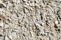 Μικρό υπόβαθρο τοίχων πετρών αμμοχάλικου Στοκ φωτογραφία με δικαίωμα ελεύθερης χρήσης