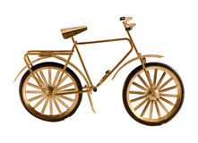Μικρό χρυσό ποδήλατο παιχνιδιών χρώματος που απομονώνεται στο λευκό Στοκ φωτογραφίες με δικαίωμα ελεύθερης χρήσης