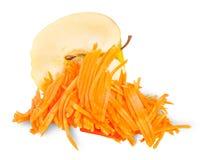 Μισή Apple με το ξυμένο καρότο Στοκ Φωτογραφία