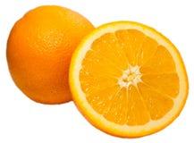 Μισό πορτοκάλι και πορτοκάλι Στοκ Φωτογραφίες