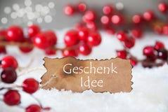 Μμένη ετικέτα, χιόνι, Bokeh, ιδέα δώρων μέσων Geschenk Idee κειμένων Στοκ εικόνες με δικαίωμα ελεύθερης χρήσης