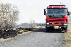 Μμένη χλόη και ένα Firetruck Στοκ εικόνες με δικαίωμα ελεύθερης χρήσης