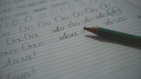 Μολύβια με το copybook απόθεμα βίντεο