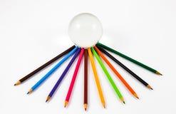 Μολύβια χρώματος με μια σφαίρα Στοκ Εικόνα