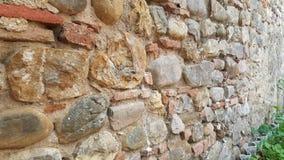 Μοναδικός αρχιτεκτονικός εκλεκτής ποιότητας τοίχος των τούβλων σε ένα κάστρο Τοσκάνη Ιταλία στοκ φωτογραφία