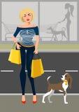 Μοντέρνη γυναίκα με ένα σκυλί κοντά στο κατάστημα Ελεύθερη απεικόνιση δικαιώματος