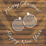Μοντέρνη κάρτα για τα συγχαρητήρια στα Χριστούγεννα και το νέο έτος Στην ξύλινη σύσταση Στοκ Φωτογραφία