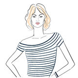 Μοντέρνο κορίτσι σε μια ριγωτή μπλούζα Στοκ εικόνα με δικαίωμα ελεύθερης χρήσης