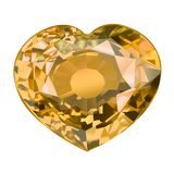Μονωμένη κίτρινη πέτρα πολύτιμων λίθων στη μορφή της καρδιάς στο άσπρο υπόβαθρο Στοκ εικόνα με δικαίωμα ελεύθερης χρήσης