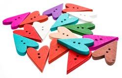 Μορφή και χρώματα καρδιών που ράβουν το υπόβαθρο κουμπιών Στοκ Φωτογραφία