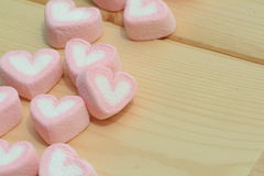 Μορφή καρδιών στο ξύλινο υπόβαθρο Στοκ Εικόνες