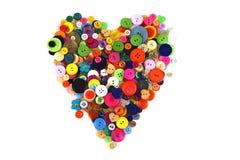Μορφή καρδιών φιαγμένη από κουμπιά ψιλικών Στοκ φωτογραφία με δικαίωμα ελεύθερης χρήσης