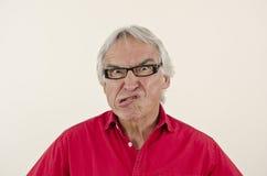 μορφασμός που καθιστά τον πρεσβύτερο ατόμων ulgy Στοκ φωτογραφία με δικαίωμα ελεύθερης χρήσης