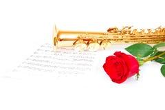 Μουσικά σημειώσεις και saxophone Στοκ Εικόνες