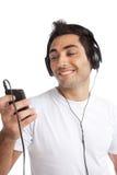 Μουσική ακούσματος ατόμων Mp3 στο φορέα Στοκ Εικόνα